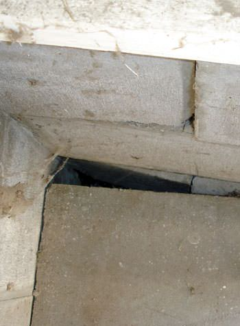 inward rotation of a foundation wall damaged by street creep in a garage in Gassville