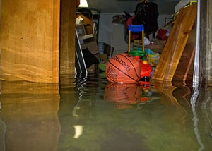 A flooded basement bedroom in West Fork